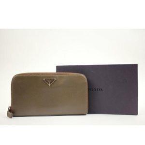 Prada brown zip around wallet.